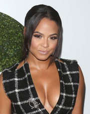 Christina Milian wore a sleek and elegant center-parted ponytail at the GQ Men of the Year party.