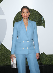 Gugu Mbatha-Raw teamed a white and gray clutch with a sky-blue pantsuit for the GQ Men of the Year party.