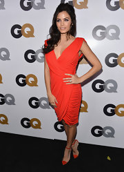Jenna heated things up at the GQ Men of the Year Party in this draped orange dress with loads of ruching.