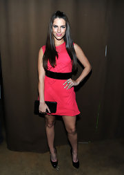 Jessica Lowndes complemented her punch pink frock with a black snake embossed hard case clutch.