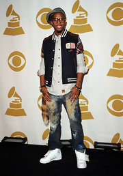 B.o.B works the preppy look in a varsity-style vest layered over a button down.