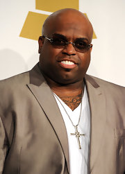 Cee-Lo added a simple touch to his taupe suit with a diamond cross pendant necklace.