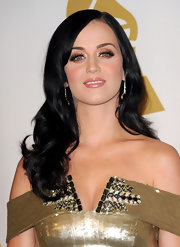 Katy's raven locks look amazing when paired with her flawless skin tone. She added soft curls to complete her look.