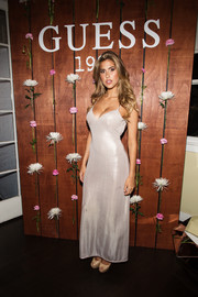 Kara Del Toro ravished in a low-cut silver slip dress at the Guess 1981 fragrance launch.
