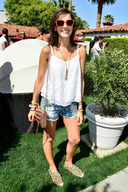 Camilla Belle toughened up her cami with a pair of ripped jean shorts by MINKPINK.