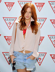 Riley Keough paired a nude button down over her swimsuit for a cool and casual look at Coachella.