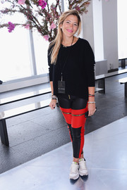 Gabriela Cadena punched up her casual look with a pair of zipper-embellished red and black leather skinnies.