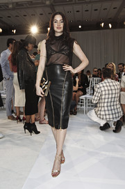 Emma Miller flashed lots of skin in a see-through black top during the Gabriela Cadena fashion show.