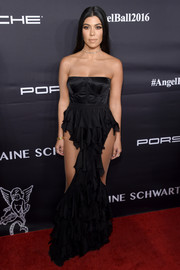 Kourtney Kardashian tantalized in a strapless corset gown by Balmain, boasting a ruffle skirt with peekaboo accents, at the Angel Ball 2016.