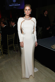 Nicky Hilton went for sultry sophistication at the Angel Ball in a two-tone evening dress with side cutouts.
