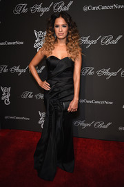 Rocsi Diaz went for a vampy look in a black strapless gown with folded accents during the Angel Ball.