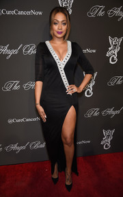 La La Anthony flaunted plenty of leg and cleavage in a high-slit, V-neck gown by Balmain during the Angel Ball.