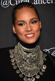 Alicia Keys rocked a metallic cat eye for a totally hip look.