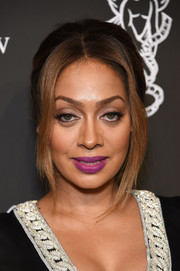 La La Anthony topped off her beauty look with a sassy purple lip.