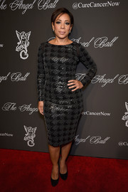 Selenis Leyva cut a curvy silhouette in a body-con houndstooth-sequined dress at the Angel Ball.