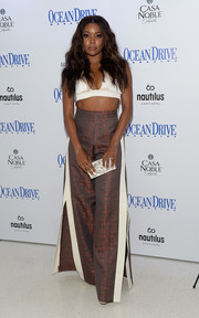 Gabrielle Union teamed her sexy top with ultra-wide-leg, side-slit pants, also by Solace London.