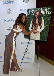 Gabrielle Union celebrated her Ocean Drive Magazine cover sporting a pair of platform sandals, side-slit pants, and a sexy crop-top.