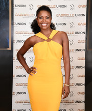 Gabrielle Union teamed some gold bangles with a yellow halter dress for the launch of her collection with New York & Company.