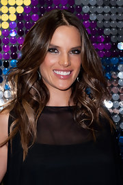 Alessandra Ambrosio wore her hair in shiny tousled waves at the Galeria Melissa flagship store opening.