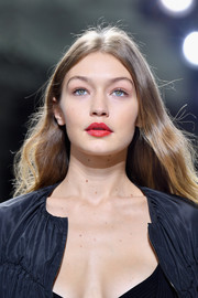 Gigi Hadid walked the Giambattista Valli runway wearing a sexy red lip.