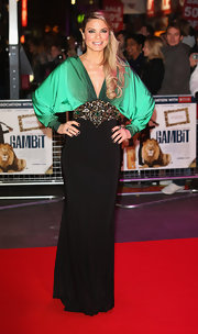 Charlotte wore this draped knit evening gown with an elaborate waist belt for the 'Gambit' world premiere in London.