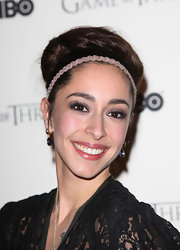 Oona Chaplin attended the 'Game of Thrones' DVD launch wearing a pair of ultra-long false lashes.