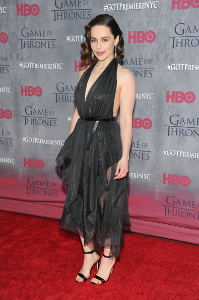 Emilia Clarke sealed off her sultry ensemble with a pair of black ankle-strap sandals.