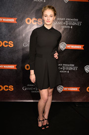 Sophie Turner paired her dress with bow-adorned black T-strap peep-toes by Christian Louboutin.