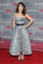Carice Van Houten continued the metallic motif all the way down to her blue Christian Dior pumps.