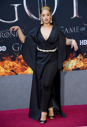 Dascha Polanco donned a dramatic black jumpsuit with draped sleeves and an overskirt for the 'Game of Thrones' season 8 premiere.