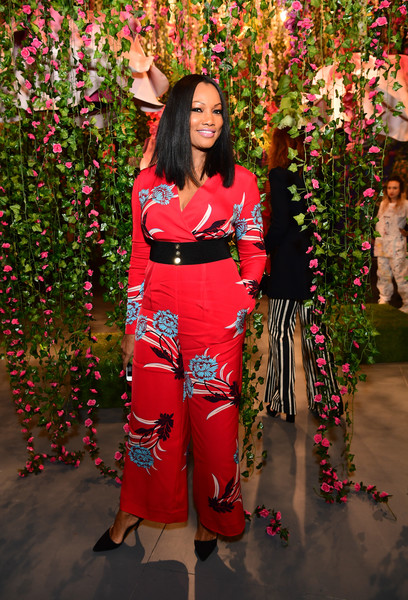 Garcelle Beauvais Jumpsuit [photo,clothing,pink,costume,long hair,plant,floral design,magenta,flower,garcelle beauvais,caption,los angeles,refinery29 29rooms,row dtla,california,refinery29,getty images,turn it into art opening night party]