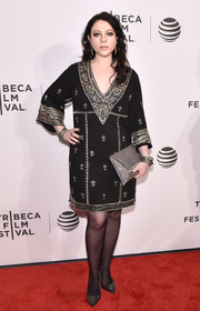 Michelle Trachtenberg attended the Tribeca Film Fest premiere of 'Geezer' looking exotic in a black tunic dress with gold embroidery.