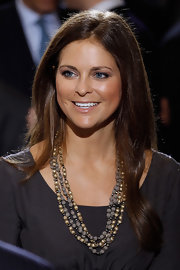 Princess Madeleine took a break from the heavy diamonds she wears to royal galas and opted for a simple beaded number at the Holocaust Remembrance Event.