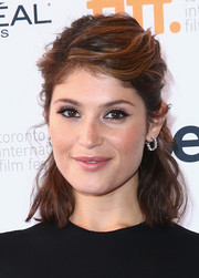 Gemma Arterton polished off her look with a pair of diamond hoop earrings.