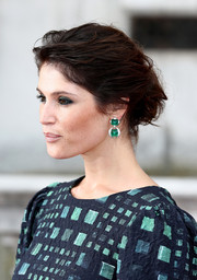 Dangling emerald earrings added a heavy dose of glamour to Gemma Arterton's look.