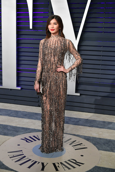 Gemma Chan Metallic Clutch [clothing,fashion,dress,fashion model,fashion design,haute couture,formal wear,long hair,shoulder,neck,radhika jones - arrivals,radhika jones,gemma chan,beverly hills,california,wallis annenberg center for the performing arts,oscar party,vanity fair,gemma chan,fashion,model,oscar party,runway,party,91st academy awards,dress,celebrity,party dress]