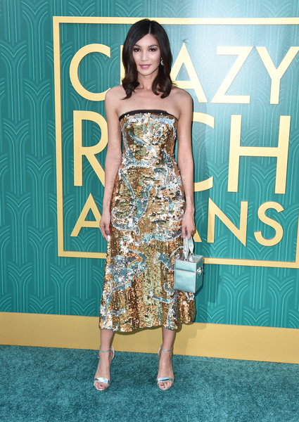 Gemma Chan Metallic Purse [crazy rich asians,crazy rich asiaans,fashion model,flooring,dress,carpet,fashion,shoulder,cocktail dress,red carpet,girl,long hair,premiere - arrivals,gemma chan,california,hollywood,warner bros. pictures,tcl chinese theatre imax,premiere]