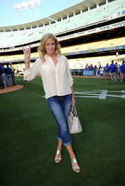 Shannon Tweed partnered her blouse with a pair of shortened fitted jeans.