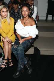 FKA Twigs contrasted her feminine top with edgy graffiti-print jeans.