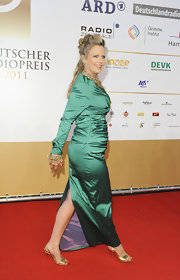 Barbara Schoeneberger teamed up her dress with a pair of lovely metallic sandals.