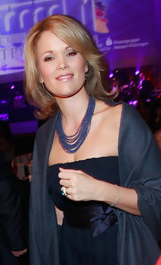 Stephanie paired her navy evening gown with a multi-layered beaded necklace.
