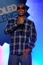 Ludacris wears a plaid button-up for his performance.