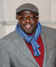 Cedric the Entertainer livened up his look with a striped blue scarf.