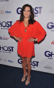 Martina McBride's Orange dress had a layered blousy effect.