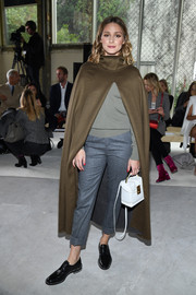For her shoes, Olivia Palermo went menswear-chic in black leather slip-ons.