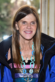 Anna dello Russo attended the Giambattista Valli fashion show wearing a sleek straight hairstyle.