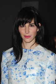 Caroline Sieber wore her hair down with jagged bangs at the Giambattista Valli fashion show.