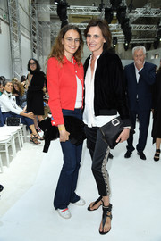 Ines de la Fressange layered a black bomber jacket over a white button-down for the Giambattista Valli Couture show.