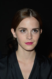 Emma Watson sported a hippie-style center-parted ponytail at the Giambattista Valli Couture fashion show.