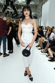 Kristina Bazan flaunted her assets in a tight white corset top while attending the Giambattista Valli Couture show.